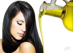 Нанесение масла на темные волосы